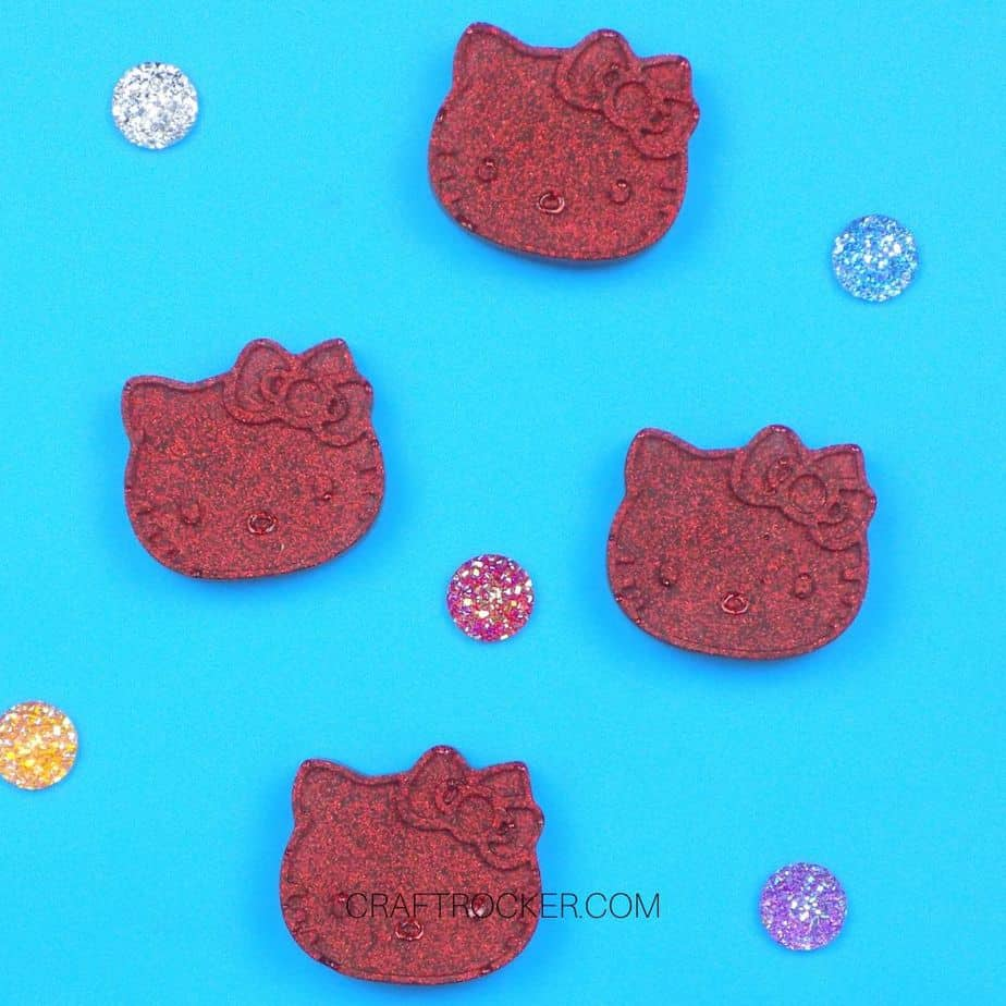 Hello Kitty Resin Magnets DIY next to Gems - Craft Rocker