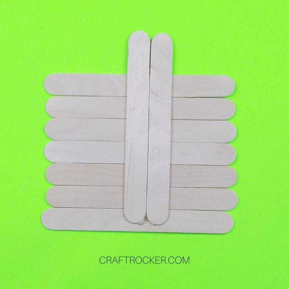 2 Popsicle Sticks Glued to Center of Horizontal Ones - Craft Rocker