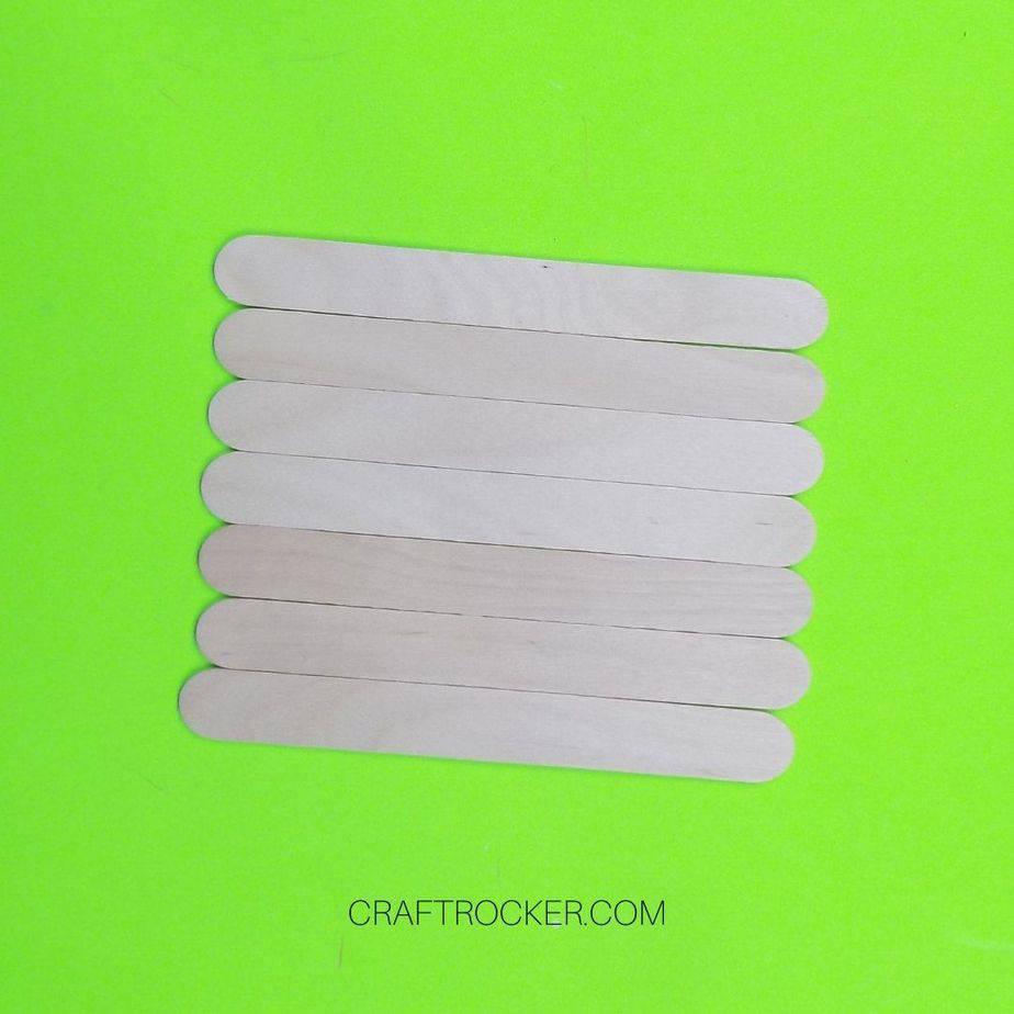 7 Popsicle Sticks Lined Up Horizontally - Craft Rocker