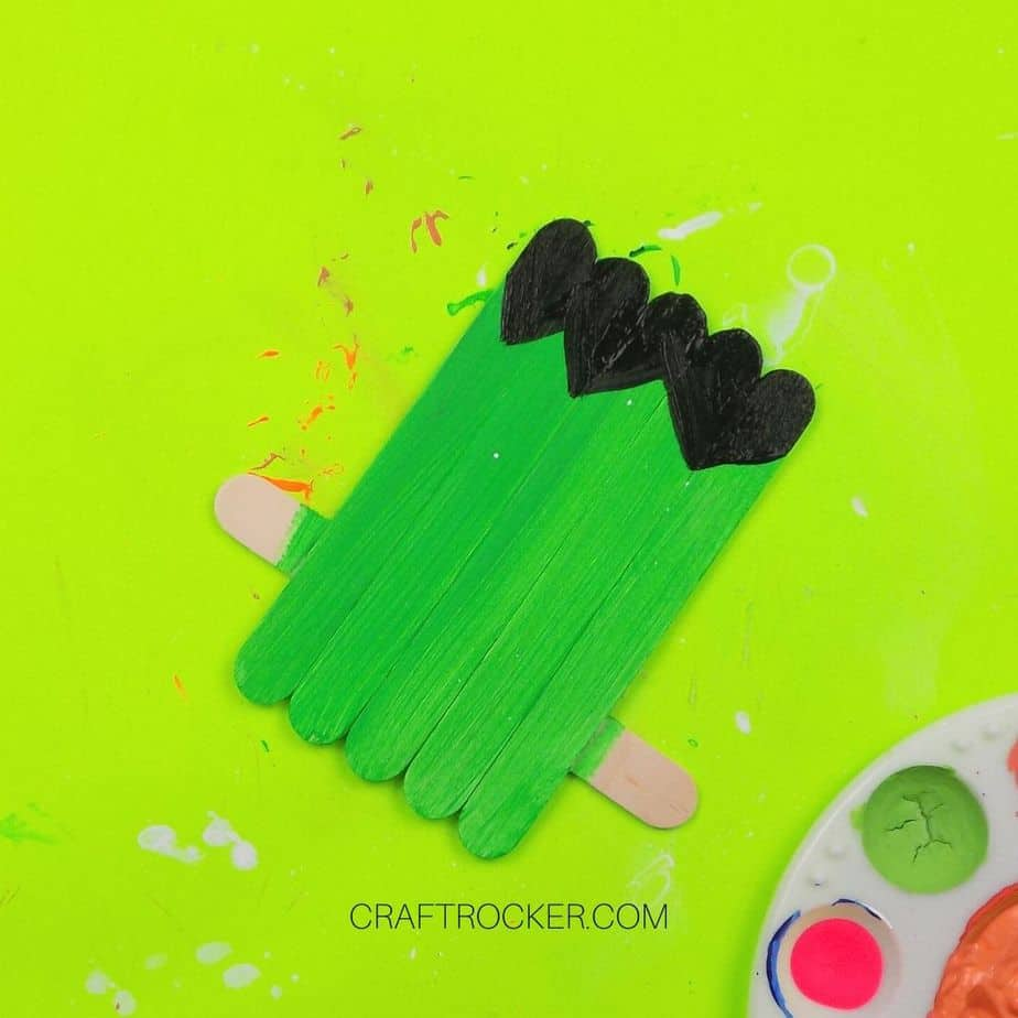 Black Painted Hair at the Top of Green Vertical Popsicle Sticks - Craft Rocker
