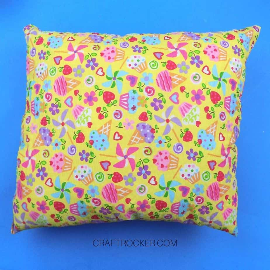 Colorful Sewn Pillow on Blue Background - Craft Rocker
