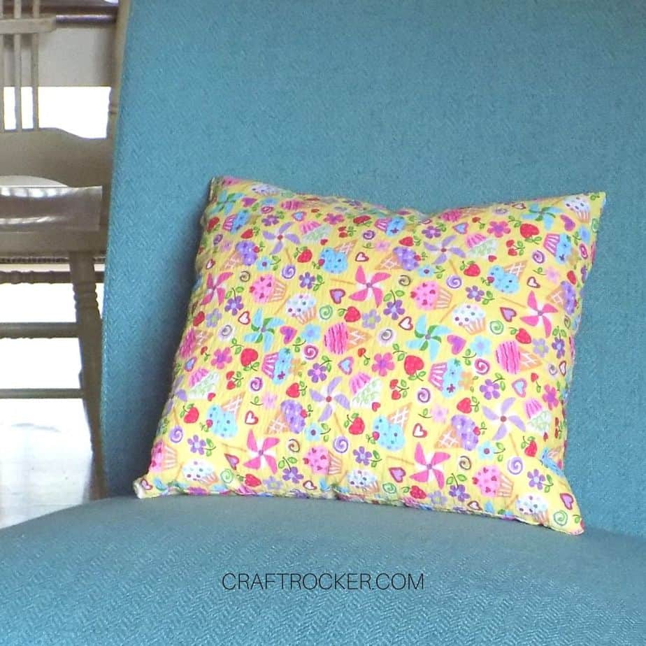 Colorful Sewn Pillow on Upholstered Chair - Craft Rocker