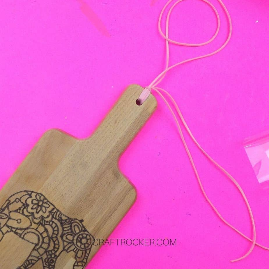 Cording attached to Wood Burned Cutting Board - Craft Rocker