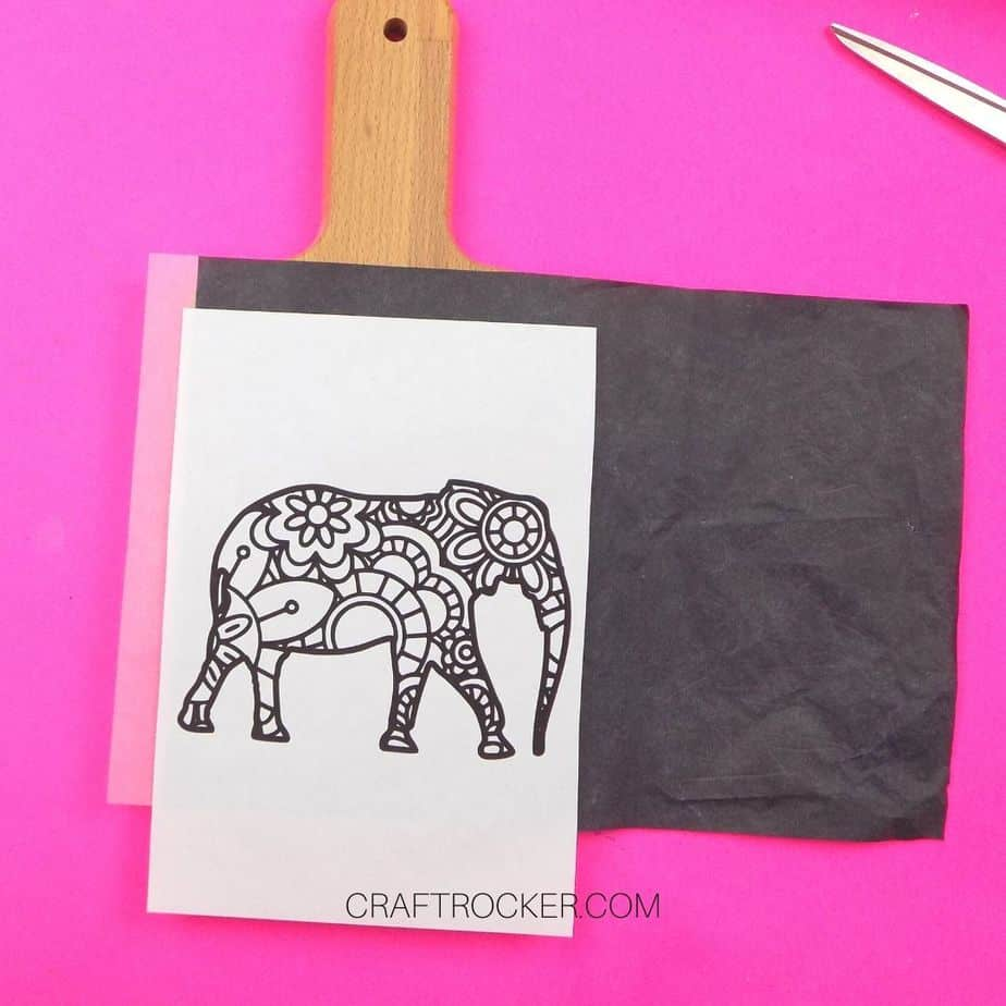 Elephant Picture and Carbon Paper on top of Wood Cutting Board - Craft Rocker