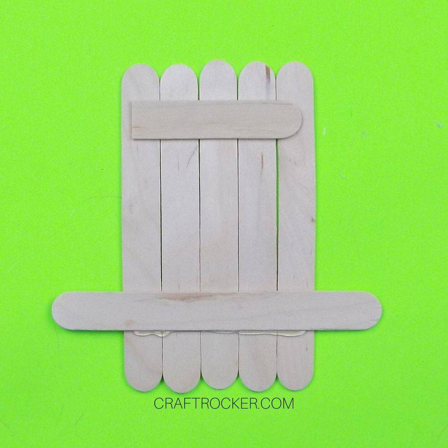 Half of a Popsicle Stick Glued to the Top of Lined Up Sticks - Craft Rocker