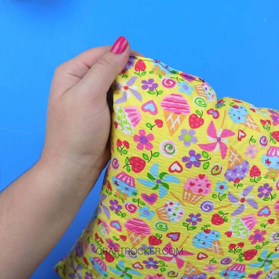 Hand Holding Final Sewn Corner on Pillow - Craft Rocker