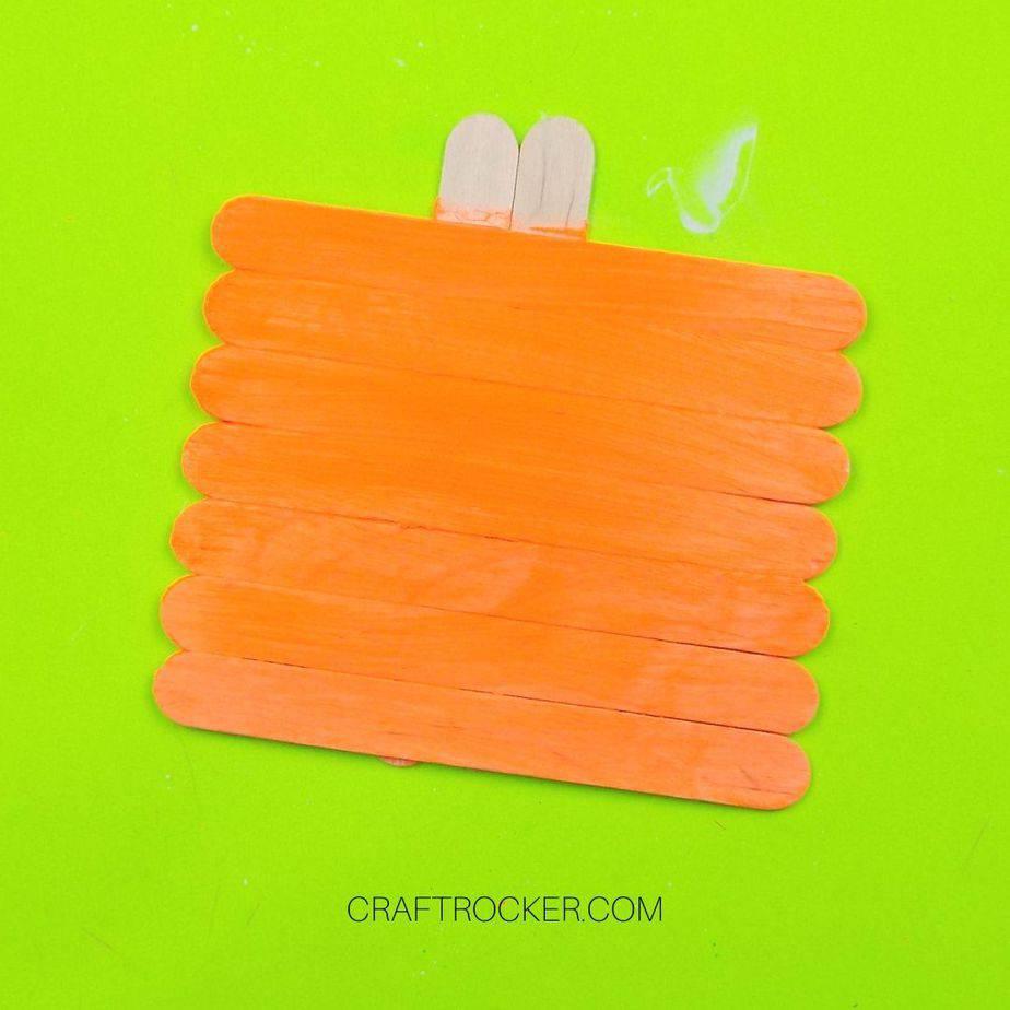 Horizontal Lined Up Popsicle Sticks Painted Orange - Craft Rocker