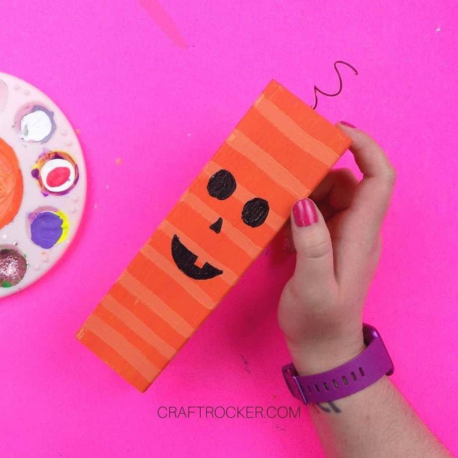 Painted Face on Large Orange Wood Pillar - Craft Rocker