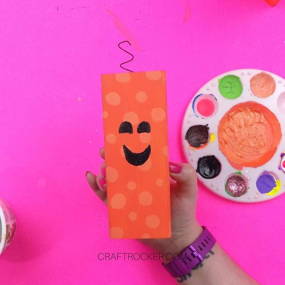 Painted Face on Medium Orange Wood Pillar - Craft Rocker