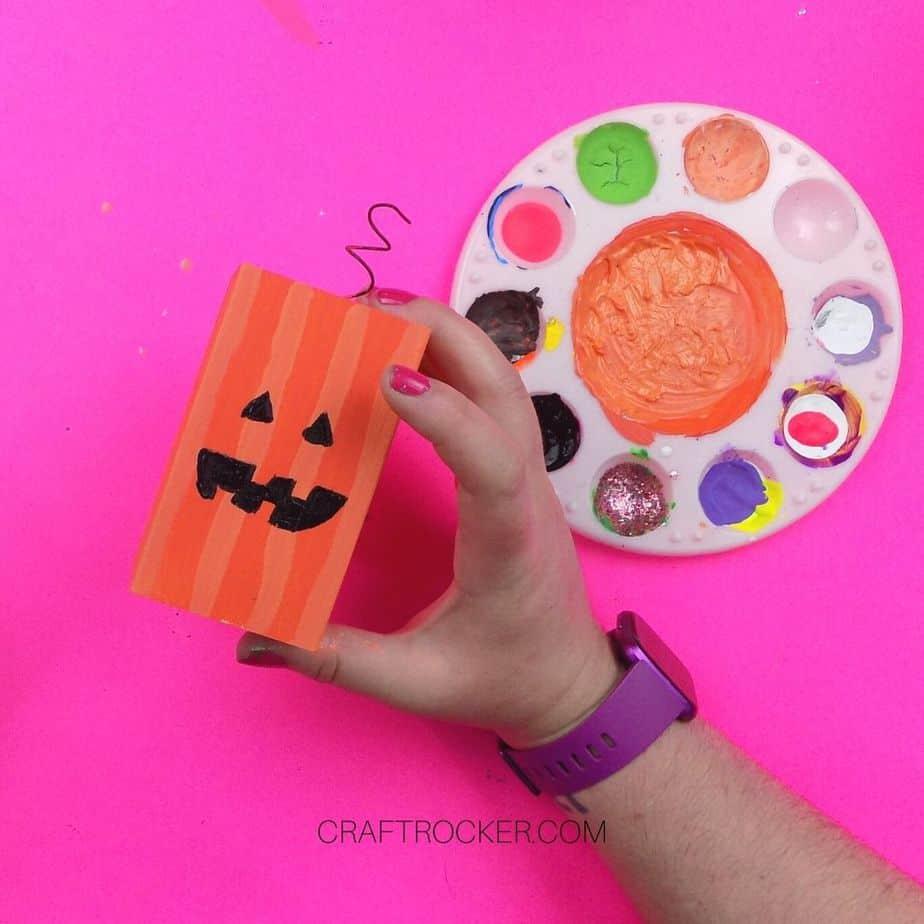 Painted Face on Small Orange Wood Pillar - Craft Rocker