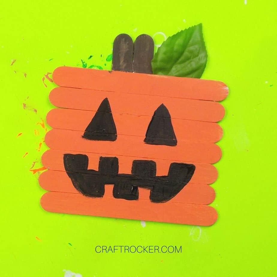 Popsicle Stick Jack-o-Lantern with Leaf Attached - Craft Rocker