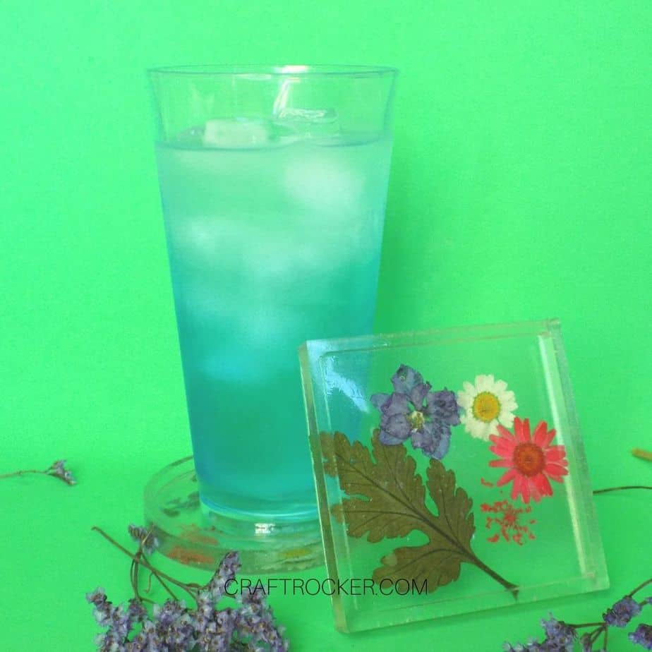 Pressed Flower Resin Coaster Leaning Against Cup - Craft Rocker
