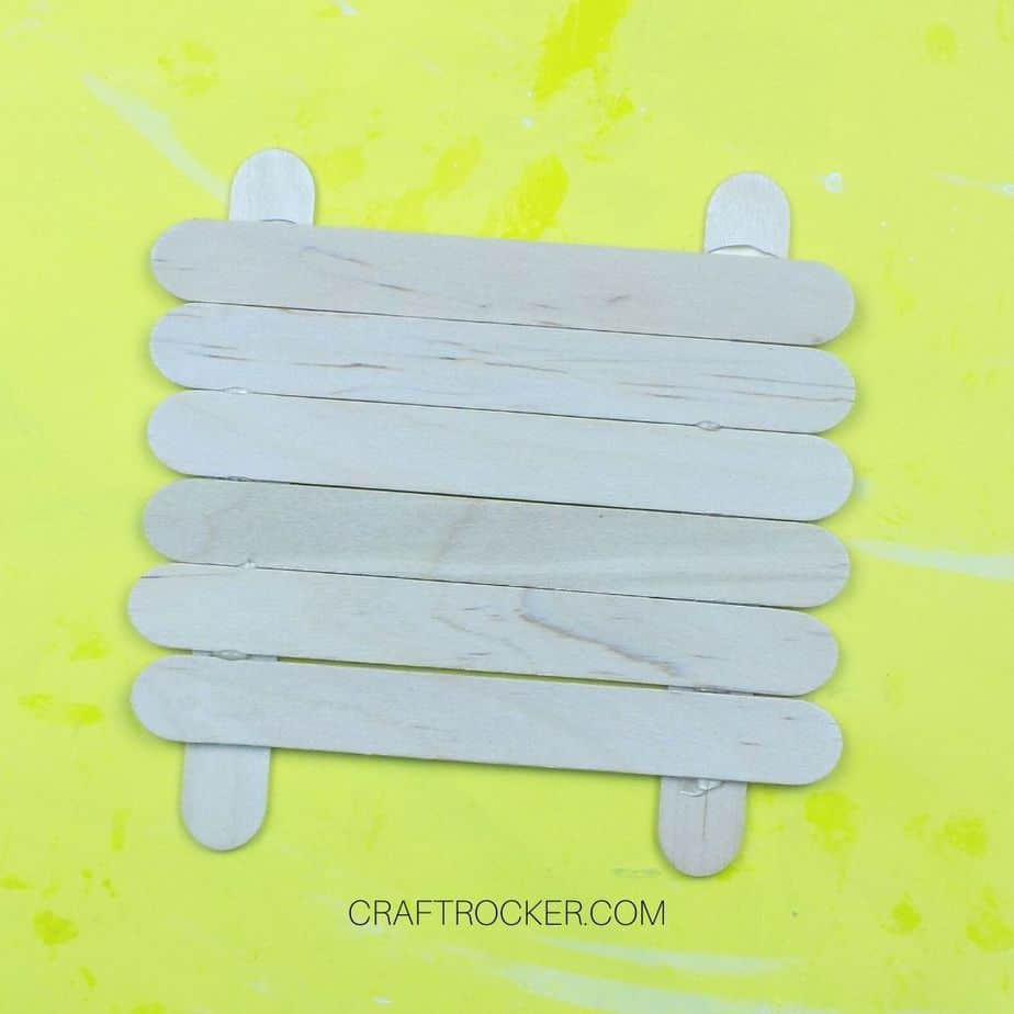Row of Crafting Sticks Glued Across 2 Parallel Craft Sticks - Craft Rocker