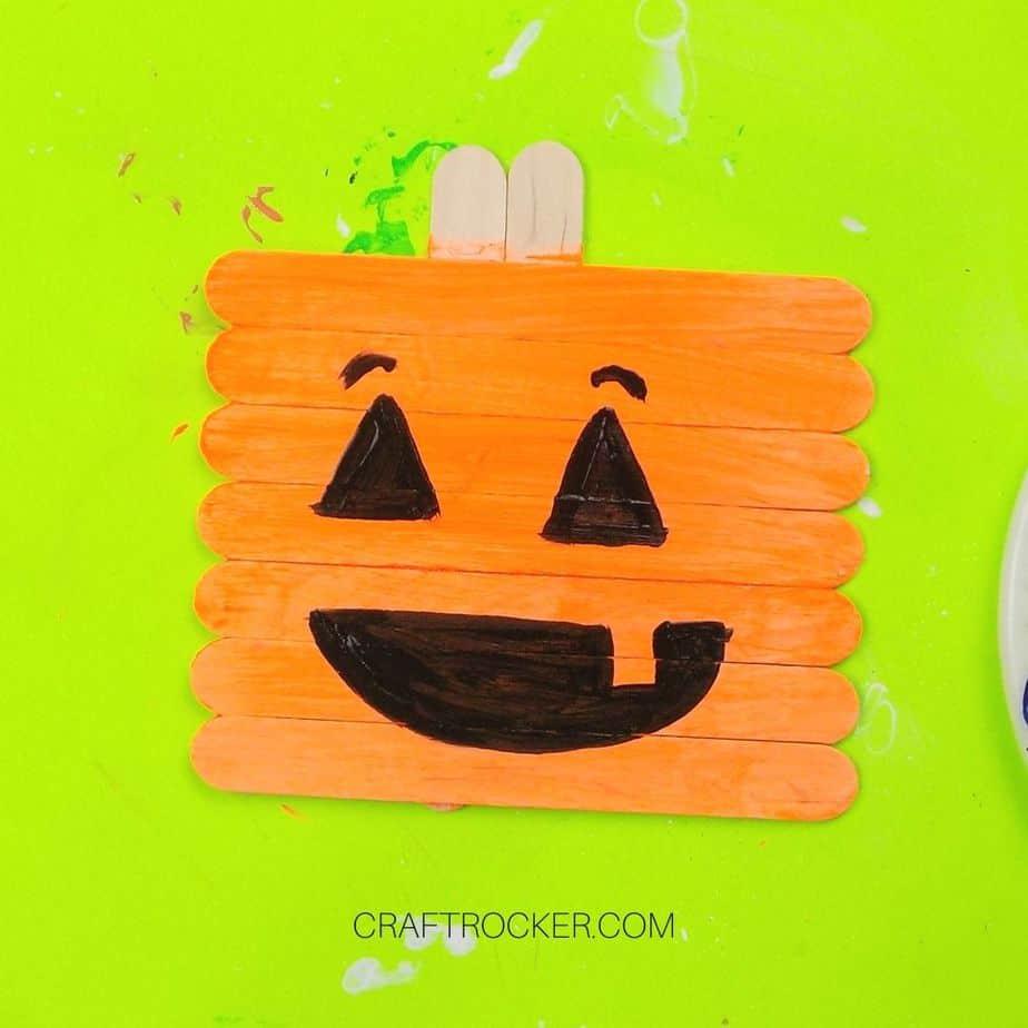 Silly Jack-o-Lantern Face Painted on Orange Popsicle Sticks - Craft Rocker