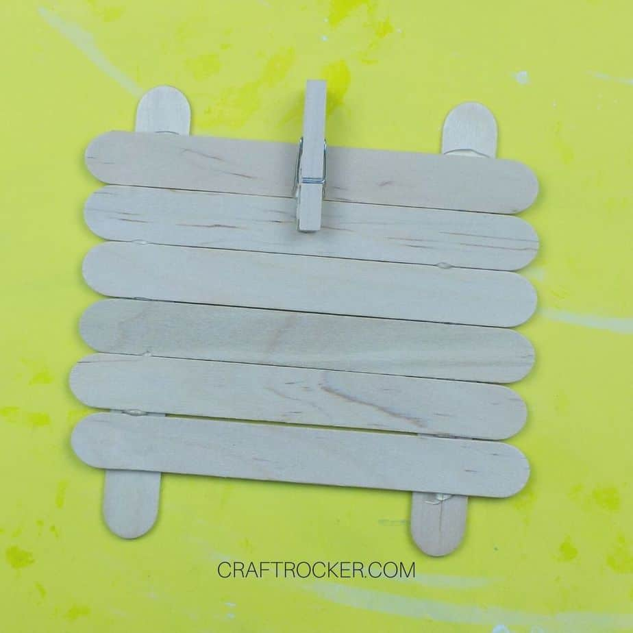 Small Wooden Clothespin Glued to Top Center of Craft Sticks - Craft Rocker
