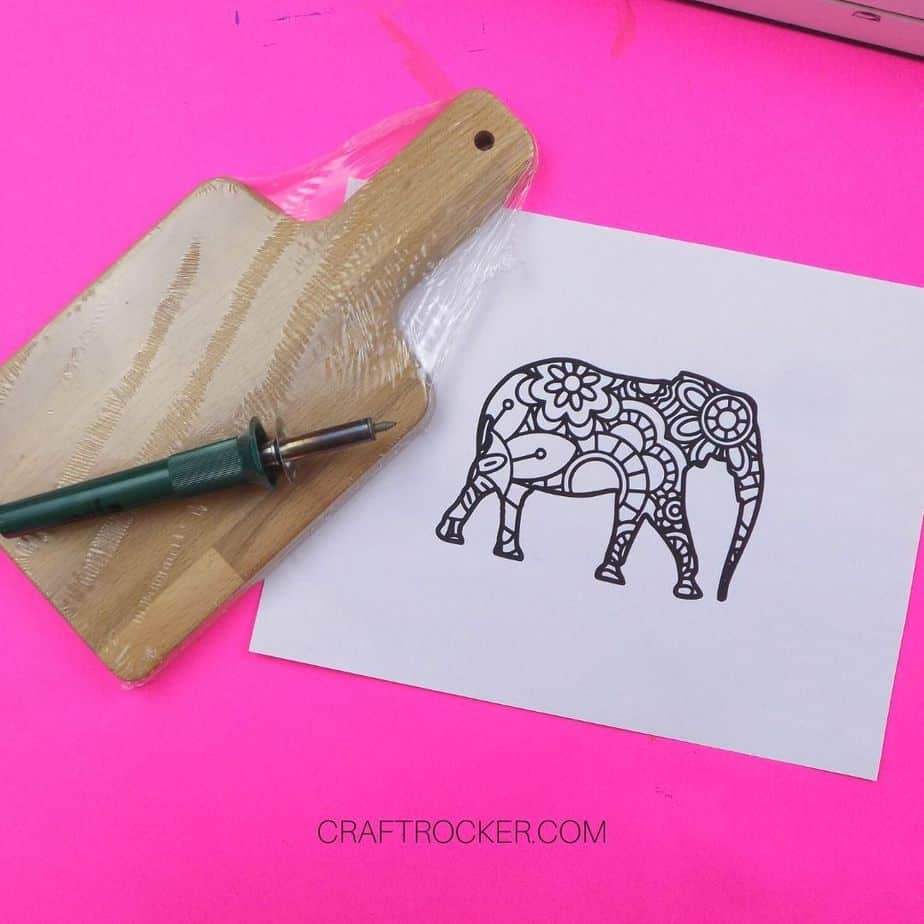 Small Wooden Cutting Board next to Wood Burning Tool and Elephant Picture - Craft Rocker