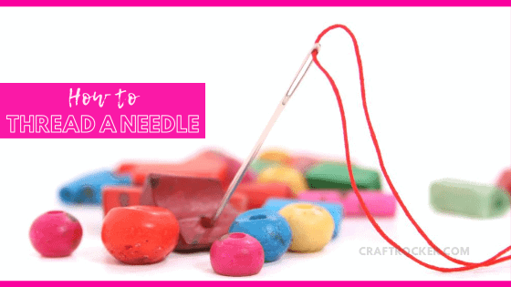 Threaded Needle next to Beads with text overlay - How To Thread a Needle - Craft Rocker