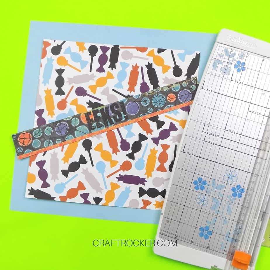 Colorful Halloween Title Border on top Trimmed Papers next to Paper Cutter - Craft Rocker