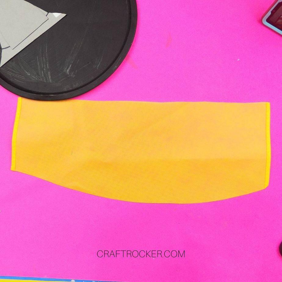 Cut Piece of Yellow Fabric next to Black Pizza Pan - Craft Rocker
