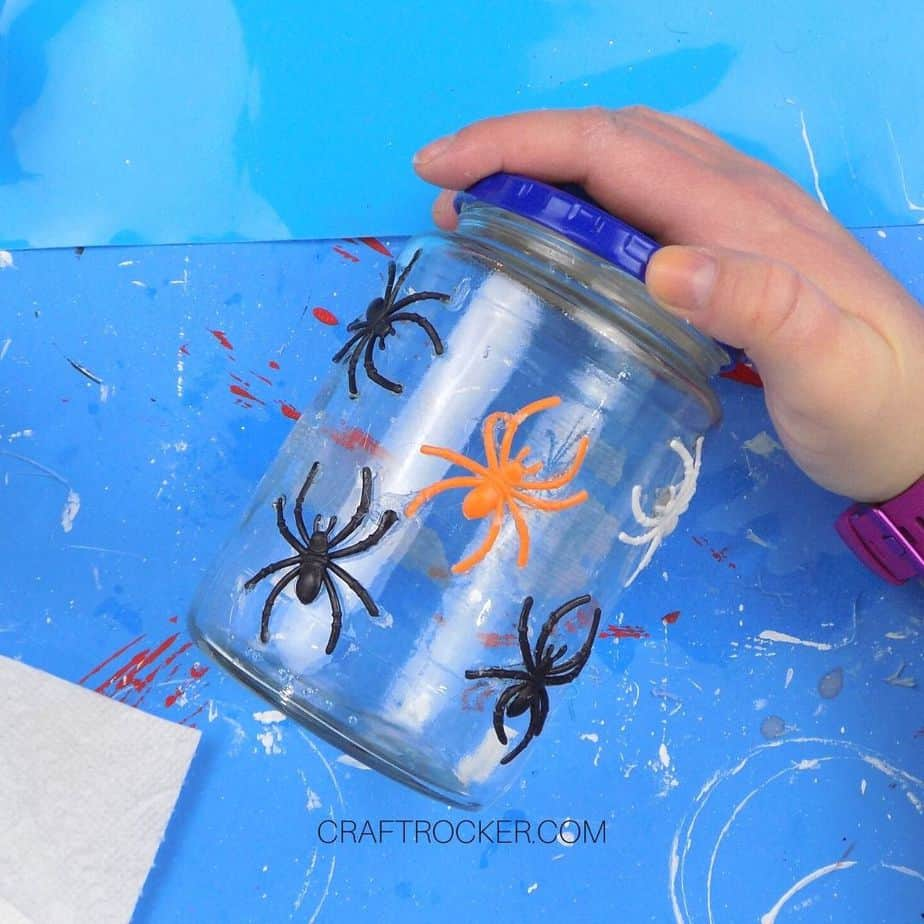 Empty Jar with Plastic Spiders Glued to It - Craft Rocker