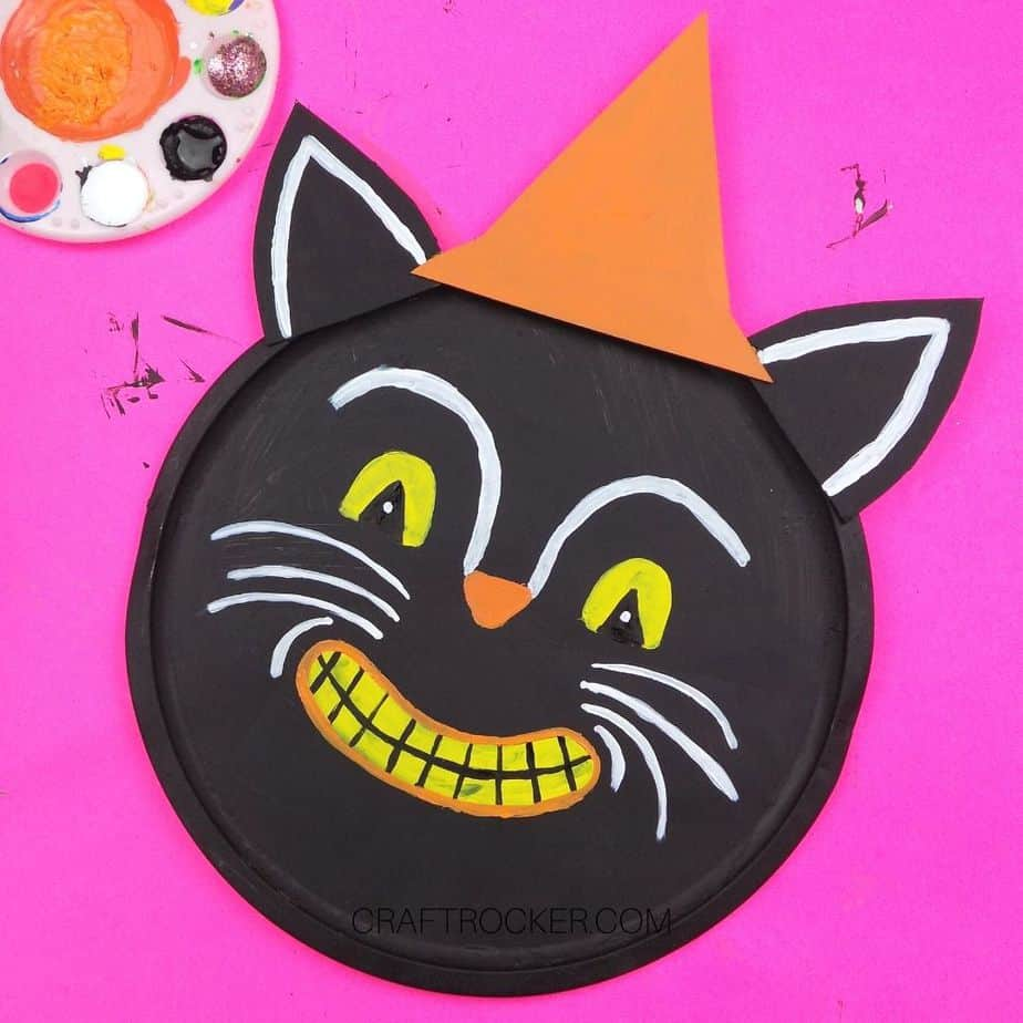 Finished Cat Face Painted on Black Cat Pizza Pan - Craft Rocker