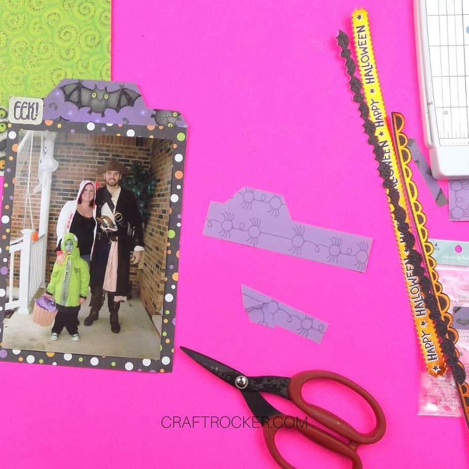 Tab Cut Out of Purple Spider Paper next to Scissors - Craft Rocker