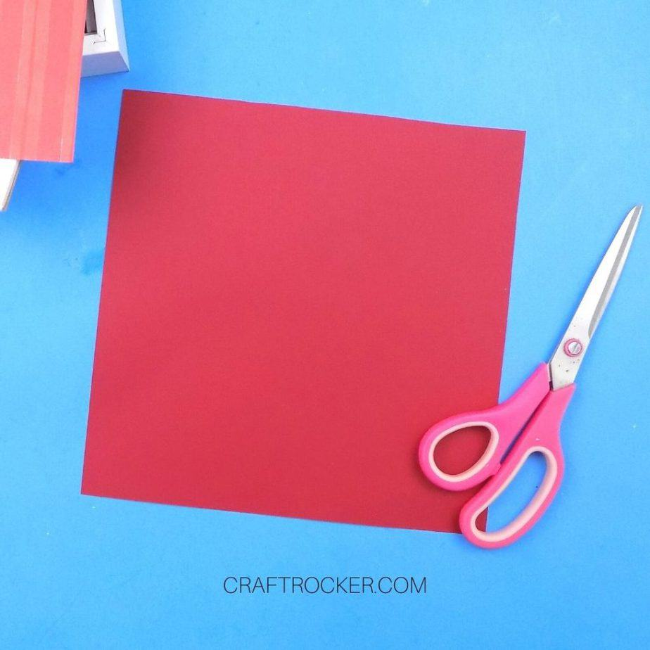 9x9 Piece of Red Cardstock next to Scissors - Craft Rocker