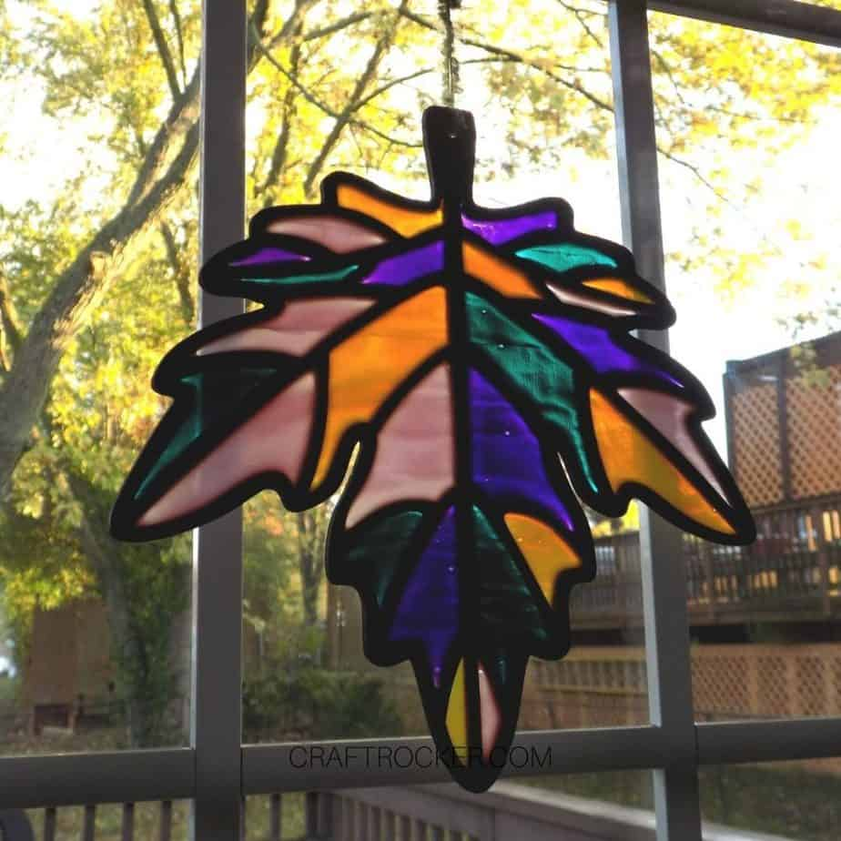 Angled Photo of Hanging Stained Glass Leaf on Window - Craft Rocker