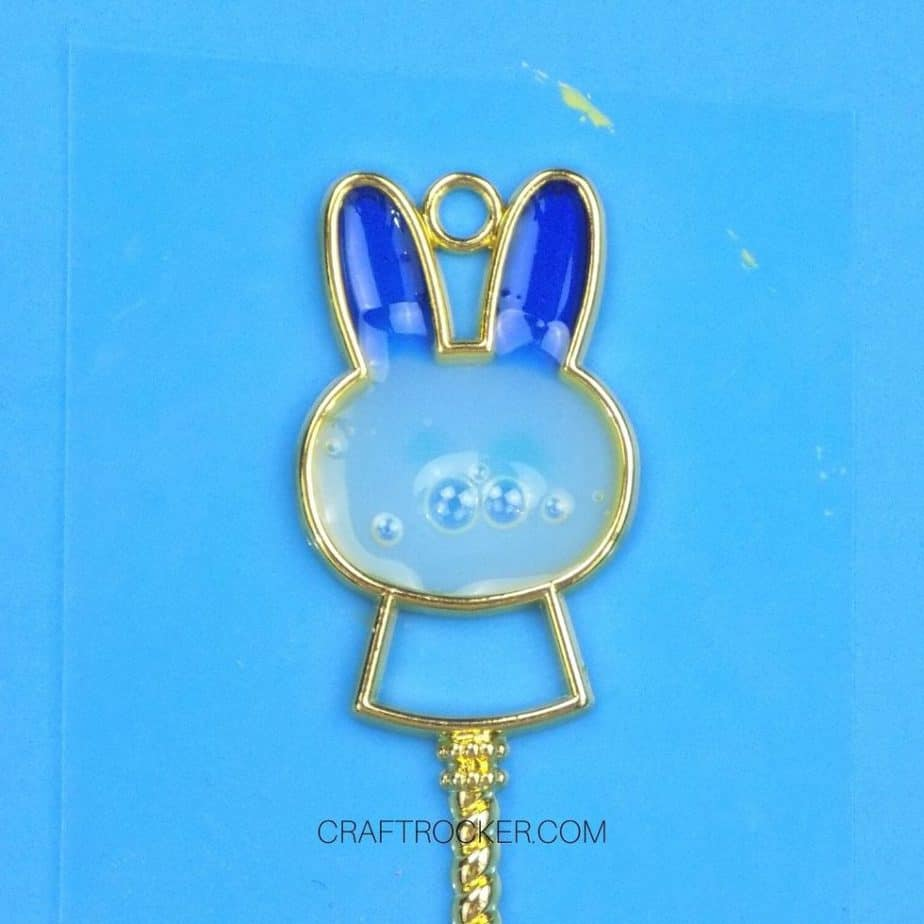 Close Up of Bubbles in White UV Resin in Head of Metal Bunny Charm - Craft Rocker