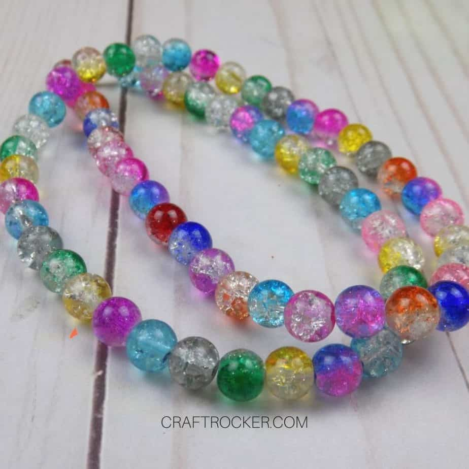 Close Up of Colorful Beaded Necklace on Wood Background - Craft Rocker