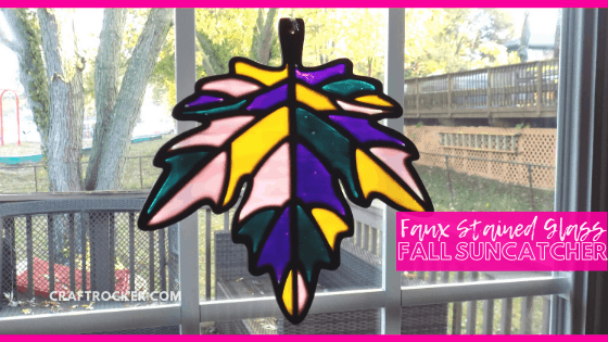 Close Up of Fall Leaf Suncatcher on Window with text overlay - Faux Stained Glass Fall Suncatcher - Craft Rocker