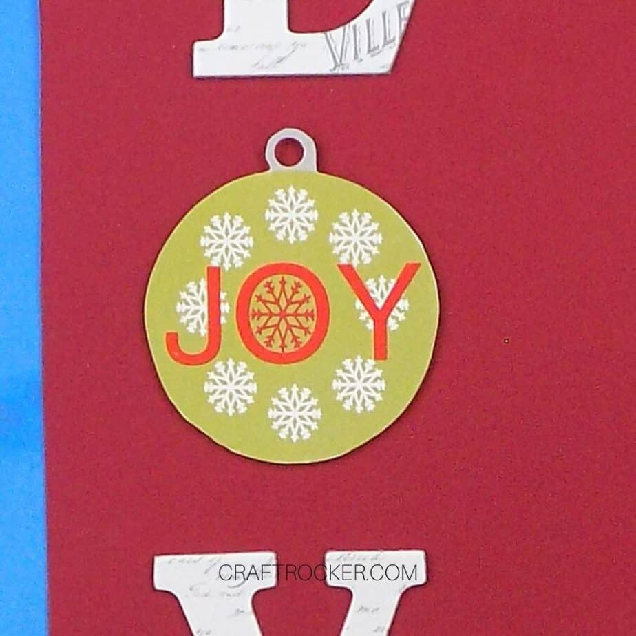 Close Up of Paper Ornament on Red Cardstock - Craft Rocker