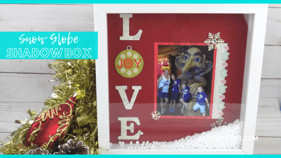 Close Up of Shadow Box on Wood Background with text overlay - Snow Globe Shadow Box - Craft Rocker