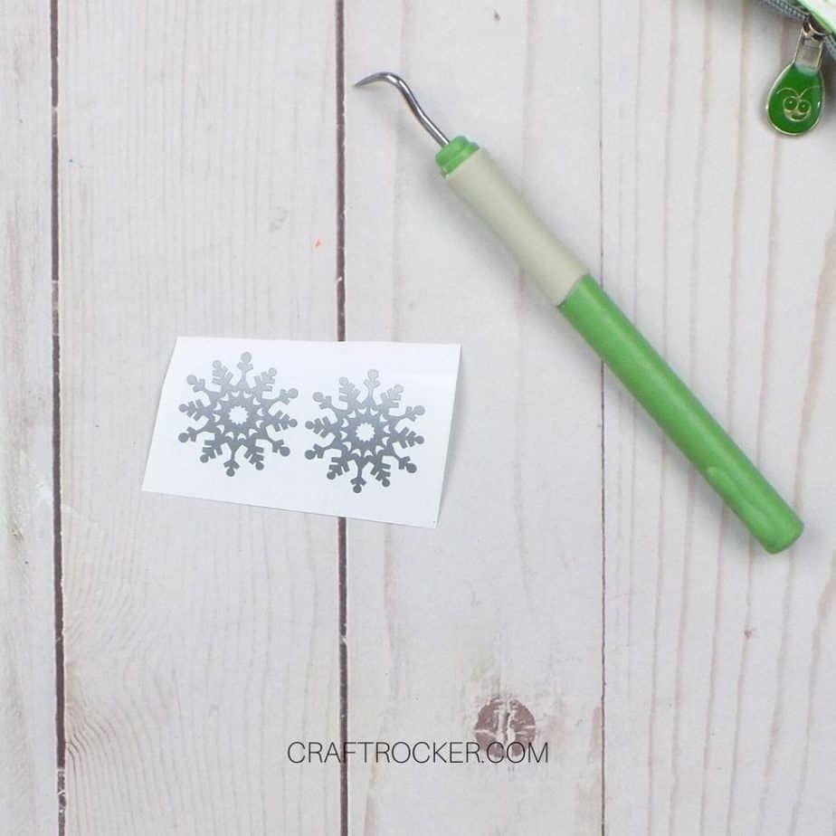 Close Up of Silver Snowflakes Next to Weeding Tool - Craft Rocker