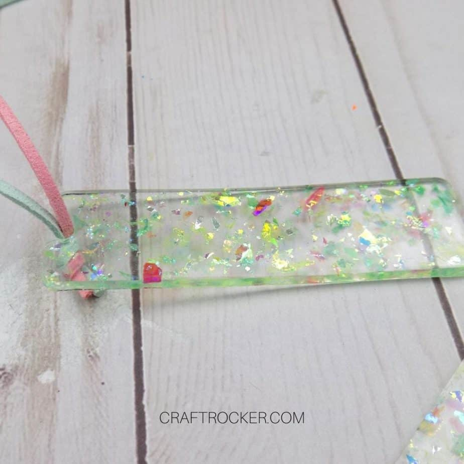Close Up of Small Holographic Glitter Resin Bookmark on Wood Background - Craft Rocker