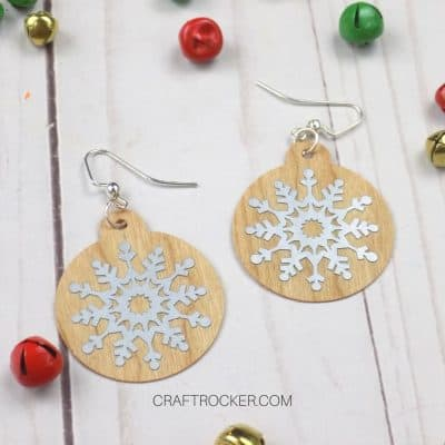 Close Up of Wood Earrings with Snowflakes next to Bells - Craft Rocker