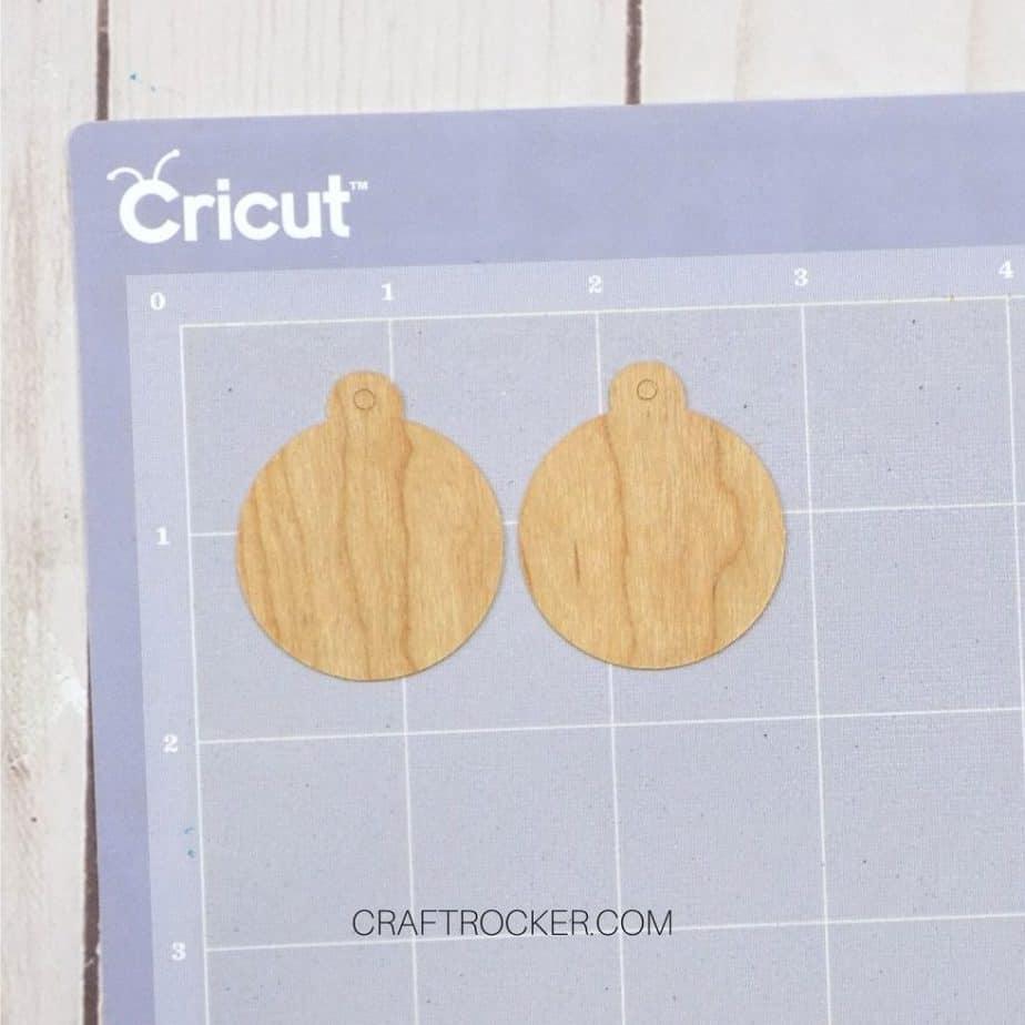Close Up of Wood Ornaments on Purple Mat - Craft Rocker