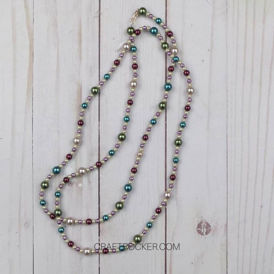 Long Beaded Necklace on Wood Background - Craft Rocker