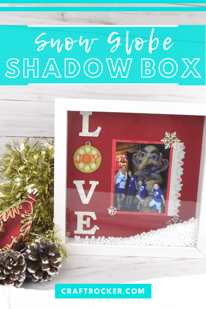 Love Shadow Box next to Garland and Christmas Ornaments with text overlay - Snow Globe Shadow Box - Craft Rocker