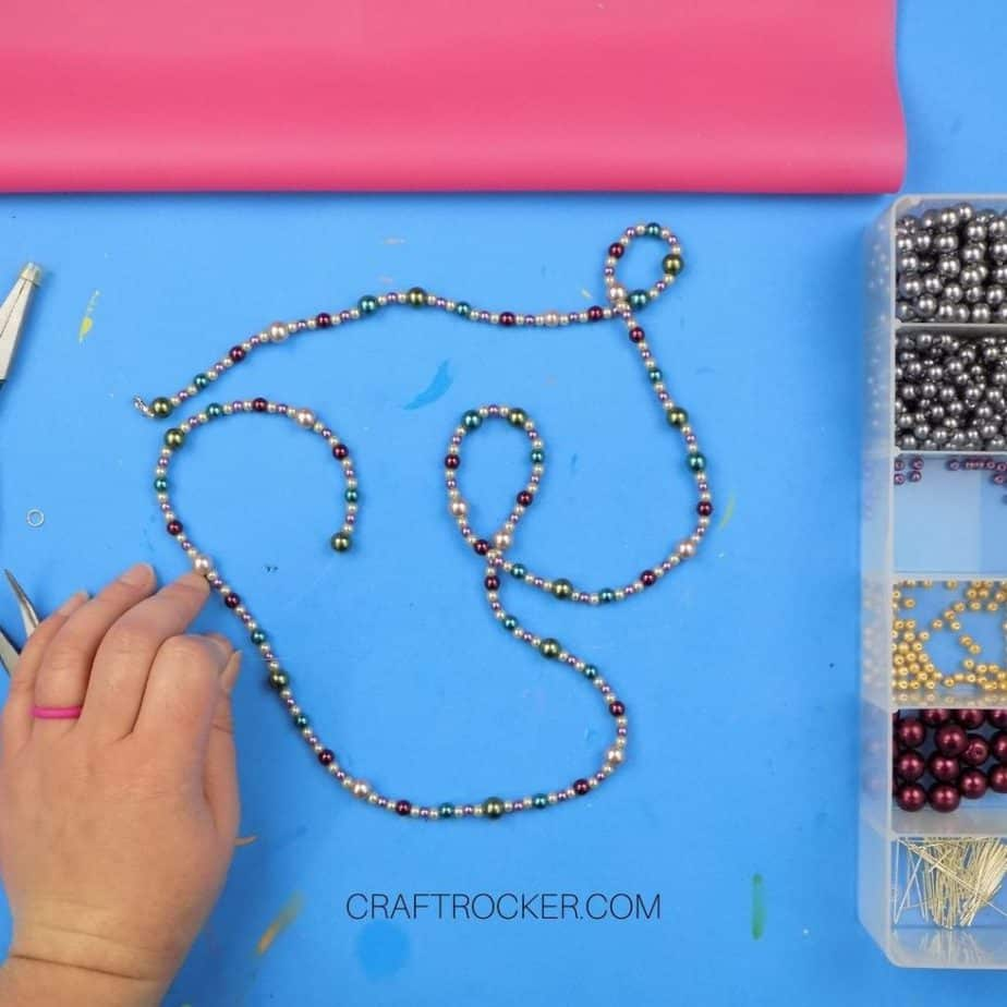 Threaded Bead Necklace next to Bead Organizer - Craft Rocker