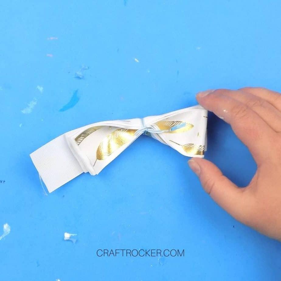 Twist Tie Secured Around Rolled Gold Feather Ribbon - Craft Rocker