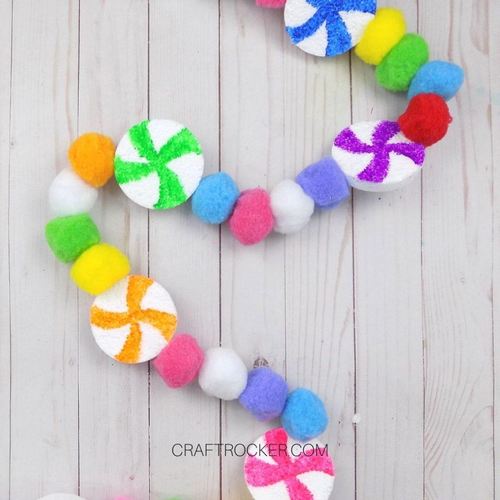 Candy Pompom Garland on Wood Background - Craft Rocker