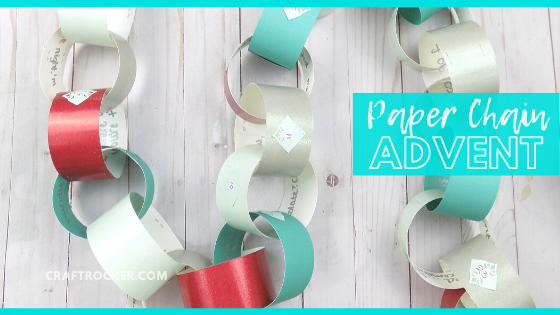 Close Up Numbered Paper Chain on Wood Background with text overlay - Paper Chain Advent - Craft Rocker