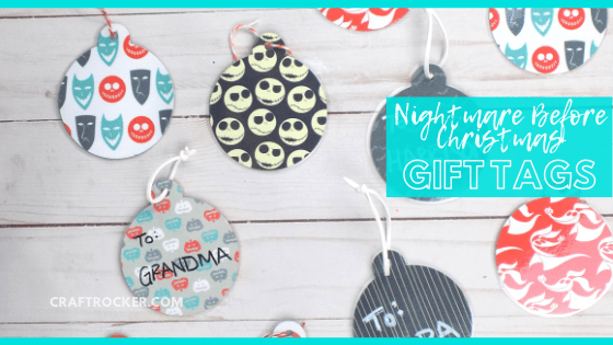 Close Up of Assorted Christmas Gift Tags on Wood Background with text overlay - Nightmare Before Christmas Gift Tags - Craft Rocker