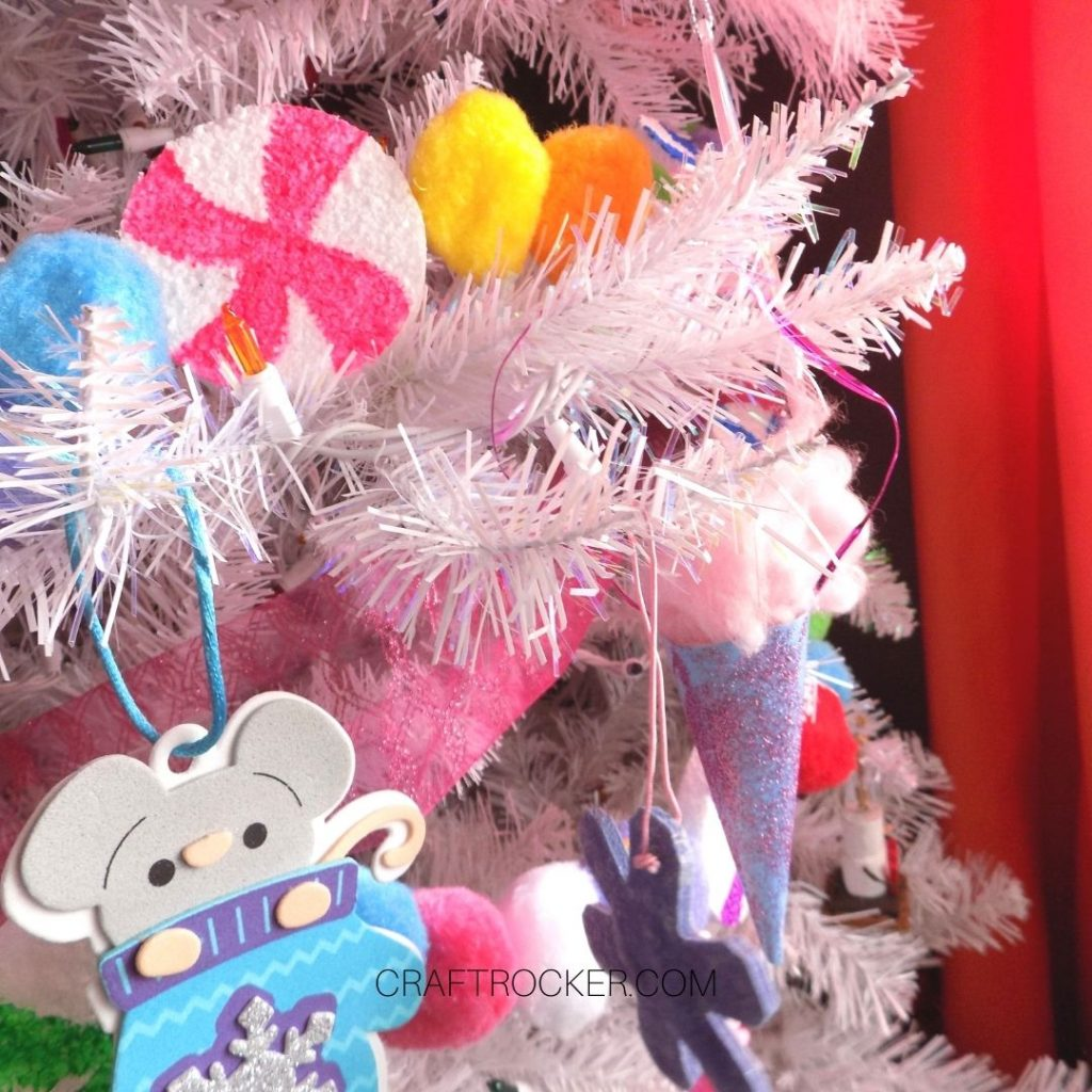 Close Up of Colorful Candy Pompom Garland on Tree - Craft Rocker