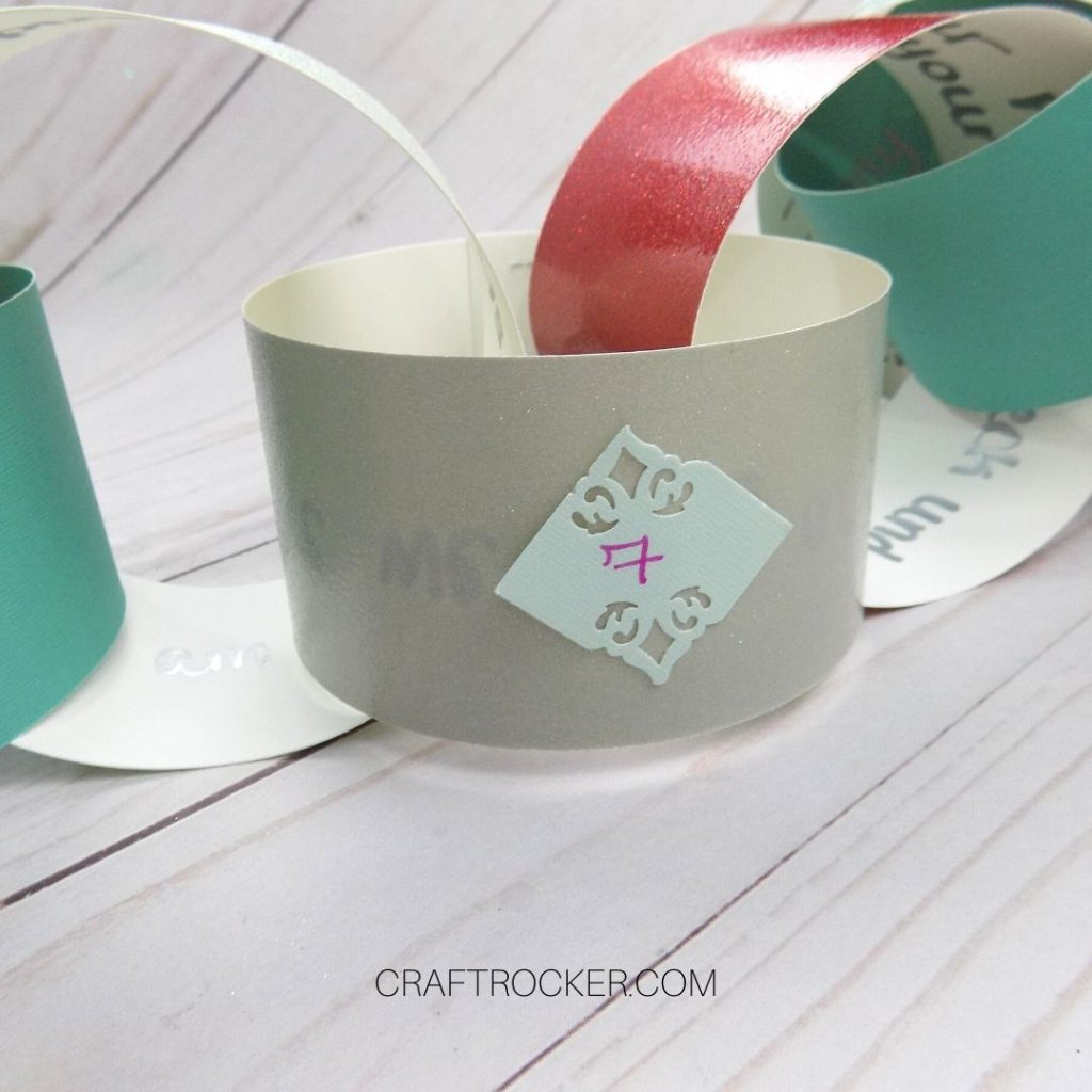 Close Up of Paper Chain Link with the Number 7 on It - Craft Rocker