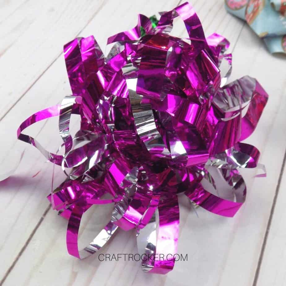Close Up of Pink Foil Fringe Wrapping Paper Bow - Craft Rocker