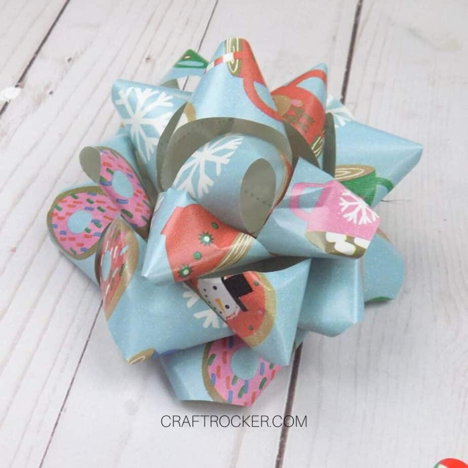 Close Up of Traditional Wrapping Paper Bow on Wood Background - Craft Rocker