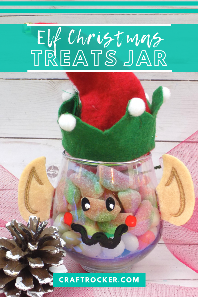 Close Up of Treat Jar next to Pine Cone with text overlay - Elf Christmas Treats Jar - Craft Rocker