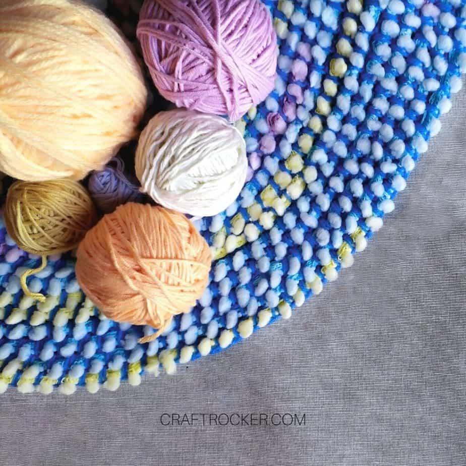 Colorful Balls of Yarn on a Rug - Craft Rocker